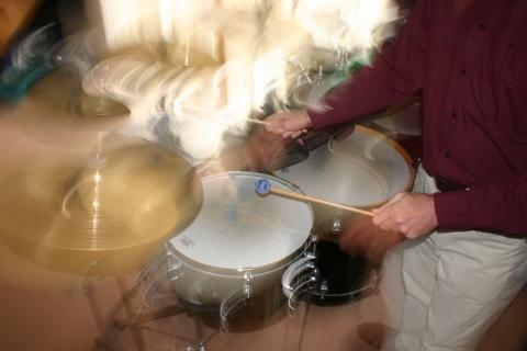 Simon O'Rorke playing cymbals and drums