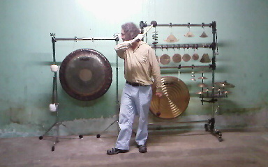 Simon O'Rorke playing gong and bell rig on 6th May 2011 in Murdoch's pickle factory, Wellington, which was demolished the next day